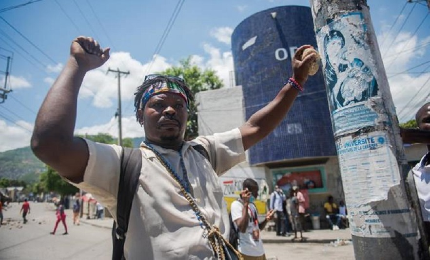 Policía, haitiana, protesta, violencia