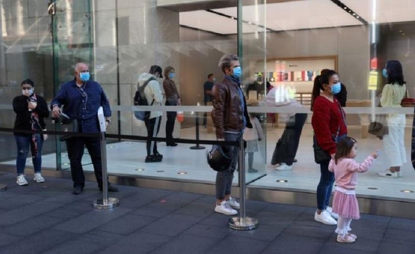 Personas con mascarillas en Sídney.