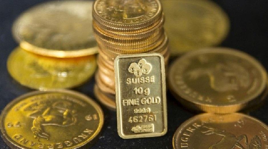 Monedas y lingotes de oro exhibidos por la firma Hatton Garden Metals en Londres. (Fuente: Reuters/Neil Hal)