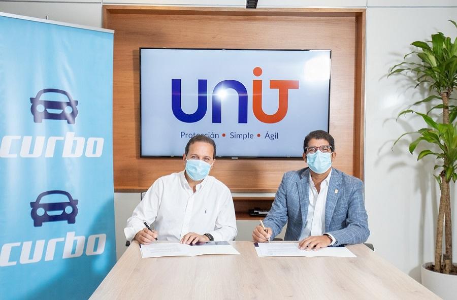 UNIT y CURBO suscriben acuerdo.